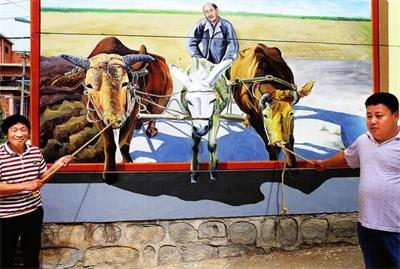 农民用彩绘装扮出美丽乡村