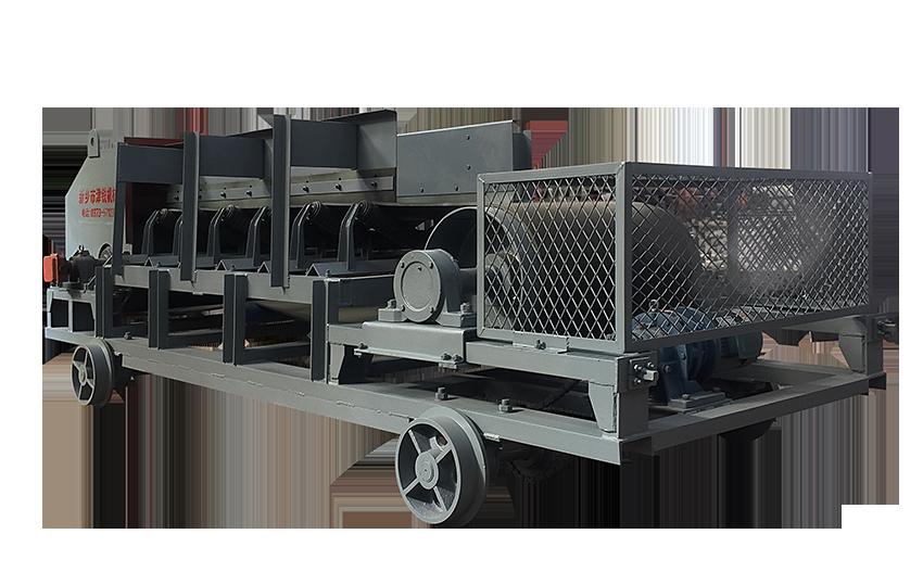 在冶金、水泥等行业的物料转运过程中,可逆配仓皮带输送机由于其可以前后往复运动的特点,能实现便利布料,因此有着广泛的应用。由于输送机在卸料时落差大,物料发生碰撞冲击,会产生大量的扬尘,且输送机由于来回移动无法采用密封导料槽,因此,扬尘迅速发散至周围环境,造成作业区环境恶化,危害操作工人健康,岗位粉尘浓度不达标